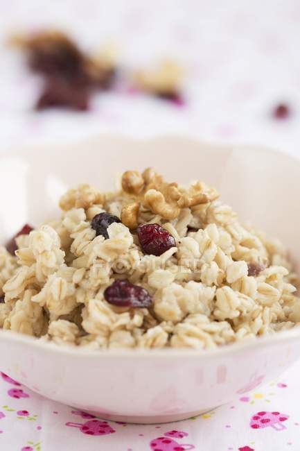 Bowl of oats with nuts — Stock Photo