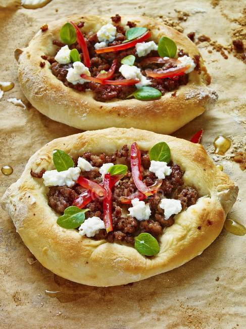Minced lamb and pizzas — Stock Photo
