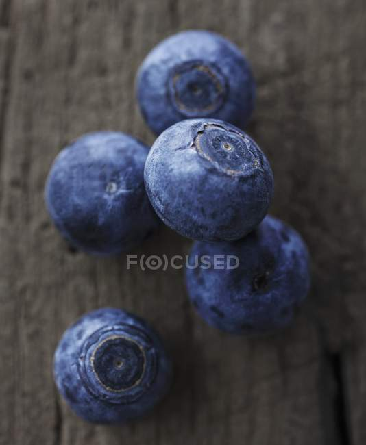 Blueberries on wooden surface — Stock Photo