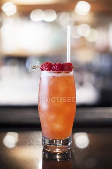 Raspberry cocktail with straw — Stock Photo