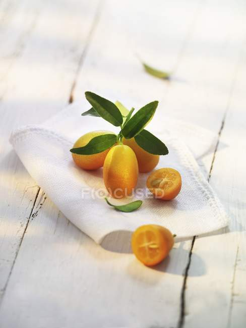 Fresh Kumquats on cloth — Stock Photo