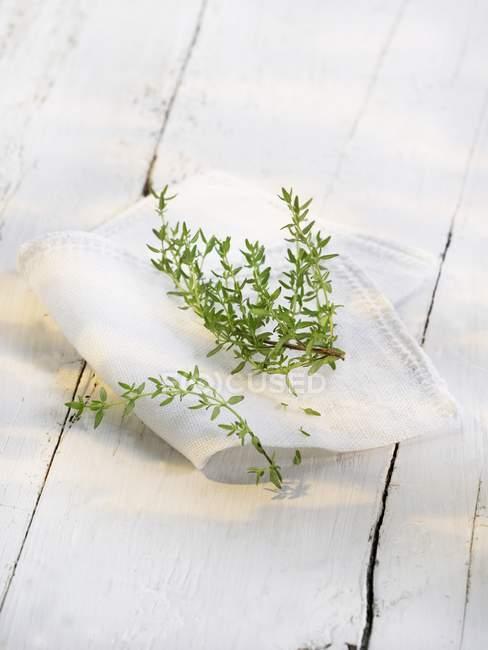 Fresh thyme on cloth — Stock Photo