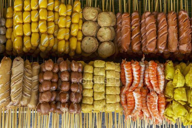 Top view of a selection of different food on skewers — Stock Photo