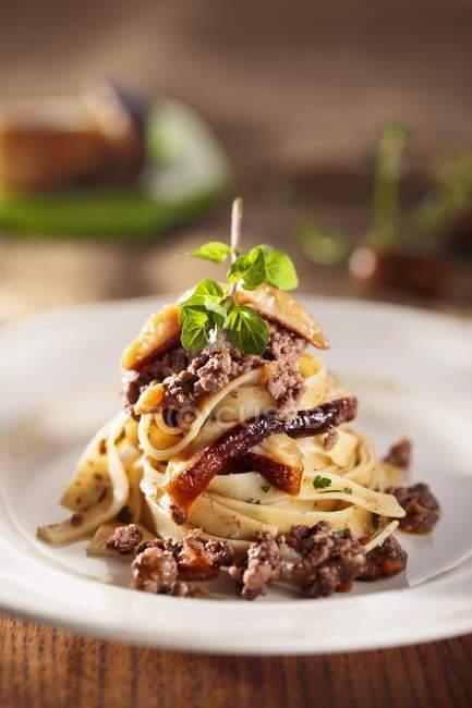 Tagliatelle pasta with wild boar ragout — Stock Photo