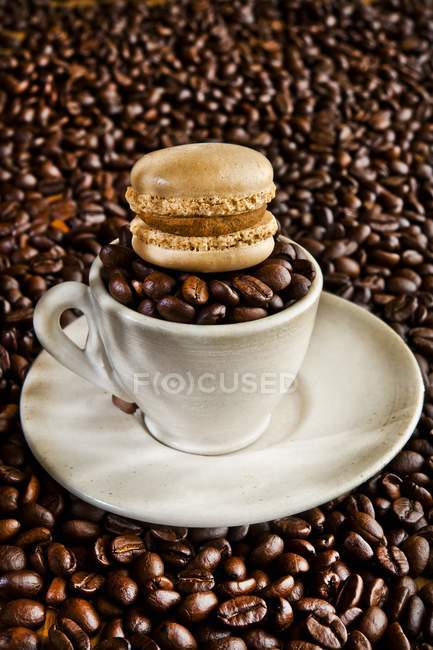 Macaroon on top of cup — Stock Photo