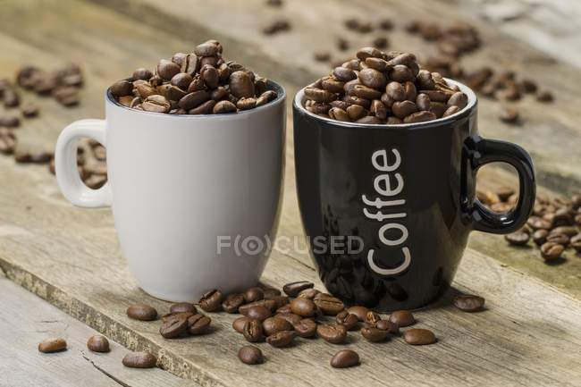 Cups filled with coffee beans — Stock Photo