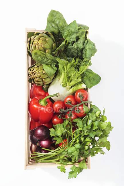 Vegetables and parsley in wooden basket — Stock Photo