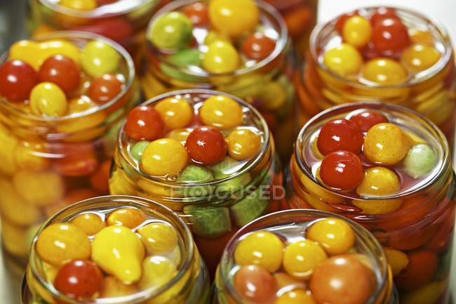 Tomatoes preserved in jars — Stock Photo