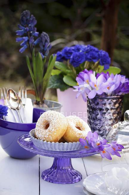 Doughnuts on table outside — Stock Photo