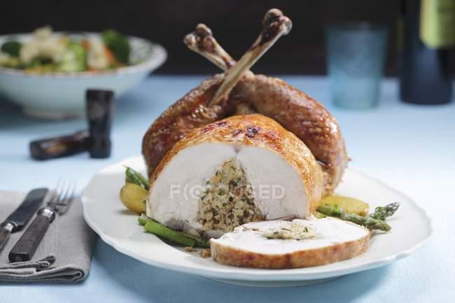 Stuffed turkey sliced at breast — Stock Photo