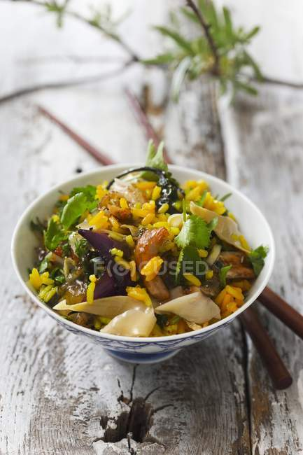 Rice with turmeric and chicken — Stock Photo