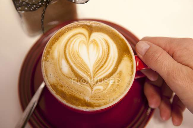 F cup of Cappuccino with heart — Stock Photo