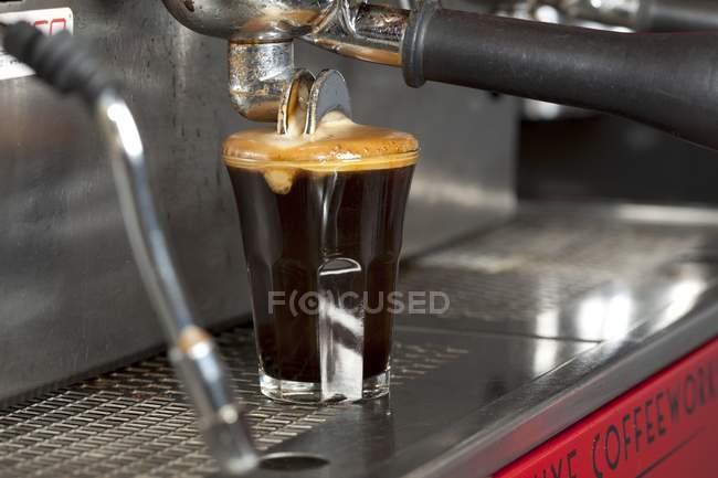Espresso Pouring From Machine into Glass — Stock Photo