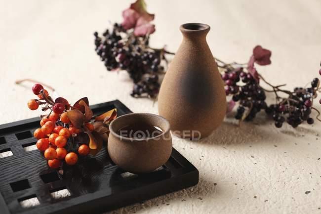 Sake rice wine in bowl — Stock Photo