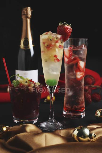 Christmas cocktails with a bottle of champagne — Stock Photo