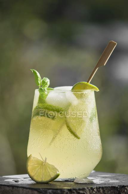 Closeup view of lime drink with ice cubes — Stock Photo