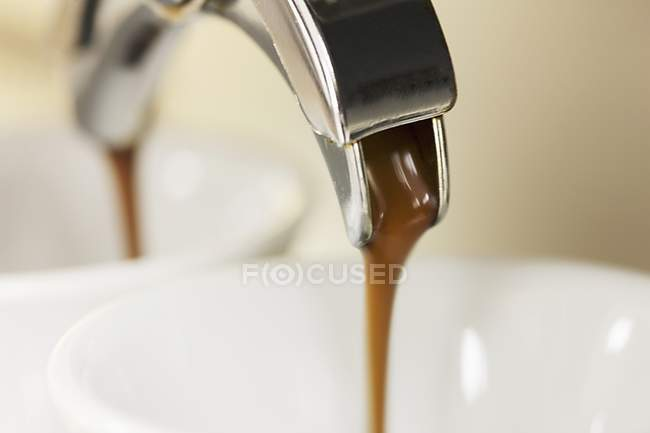 Hot espresso running into cup — Stock Photo
