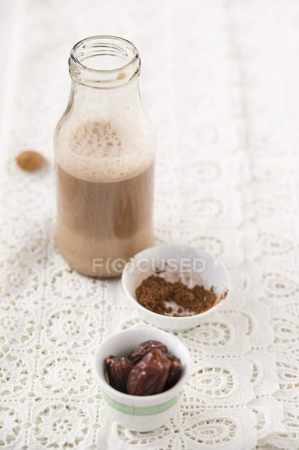 Closeup view of homemade almond milk sweetened with cocoa and dates — Stock Photo