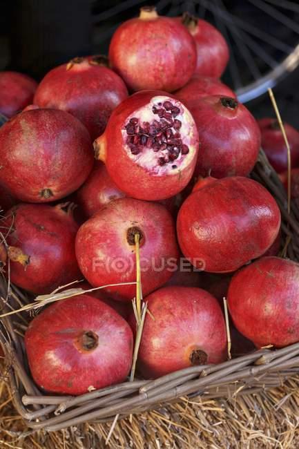 Basket of fresh pomegranates — Stock Photo