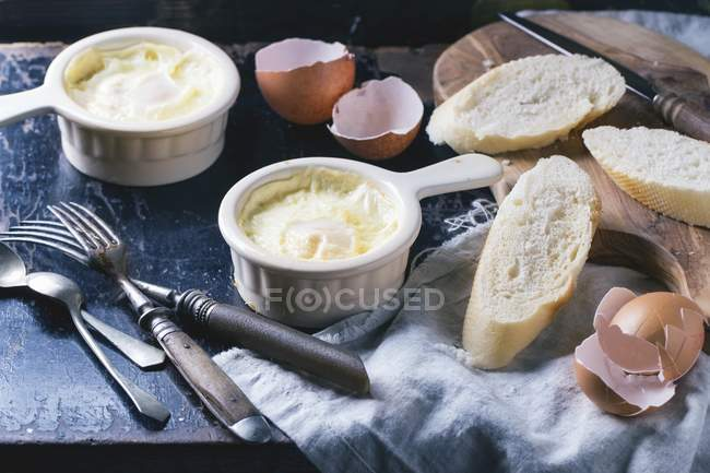 Baked eggs with bread — Stock Photo