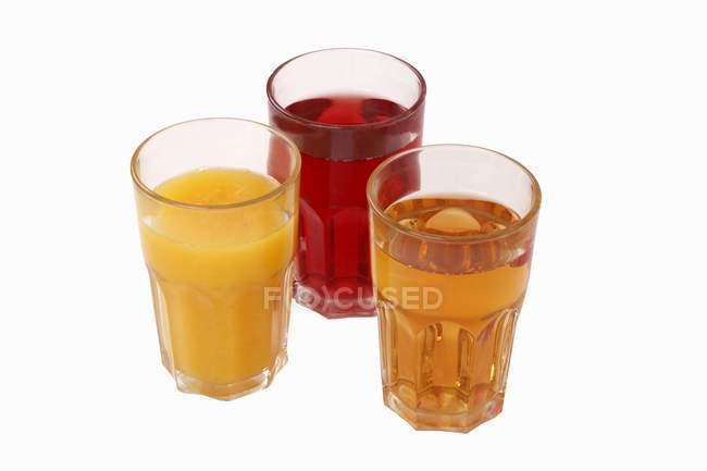 Varios zumos de fruta - foto de stock