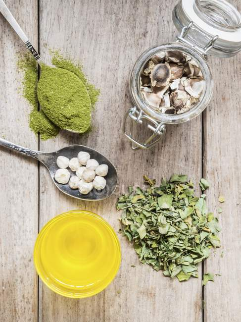 Various Moringa products on wooden surface — Stock Photo