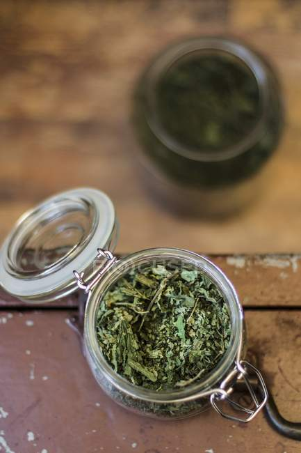 Closeup top view of a dried herbal mixture in a preserving jar — Stock Photo