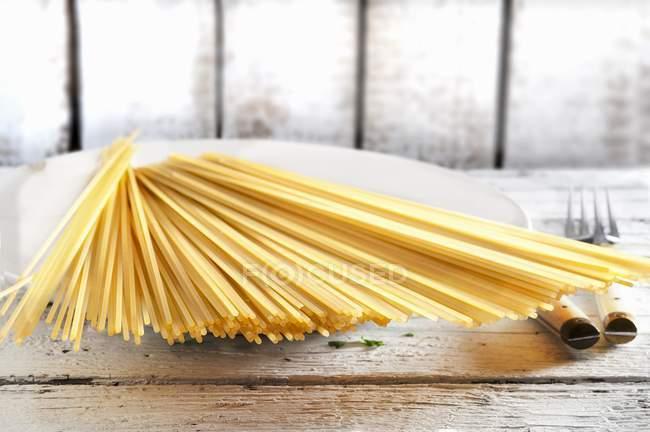 Bundle of raw spaghetti pasta — Stock Photo