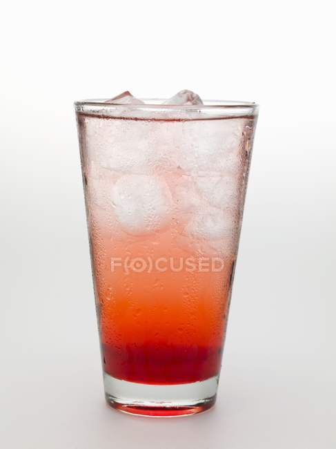 Tequila Sunrise with ice cubes — Stock Photo