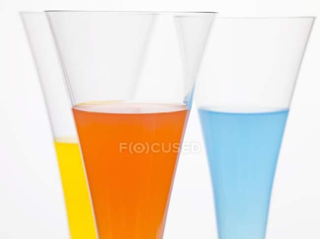 Different cocktails in elegant glasses — Stock Photo
