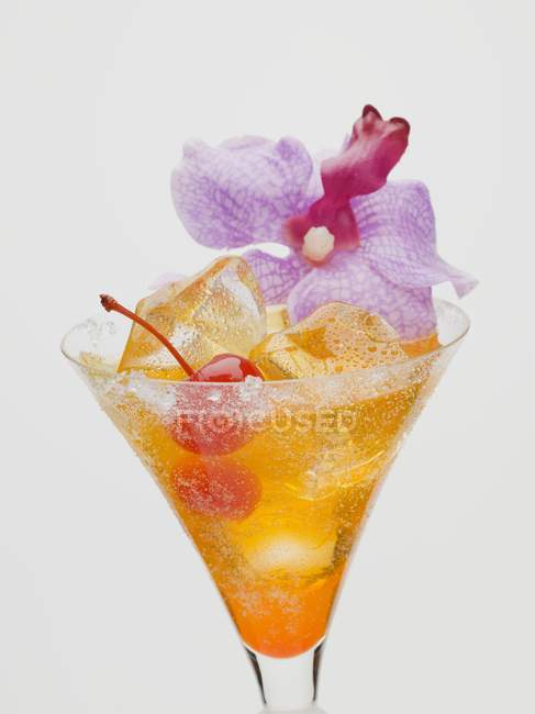 Tequila Sunrise with cocktail cherry — Stock Photo