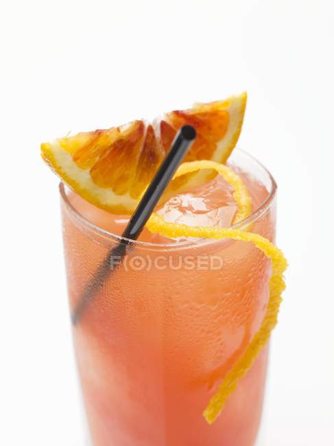 Closeup view of blood orange drink with ice cubes — Stock Photo