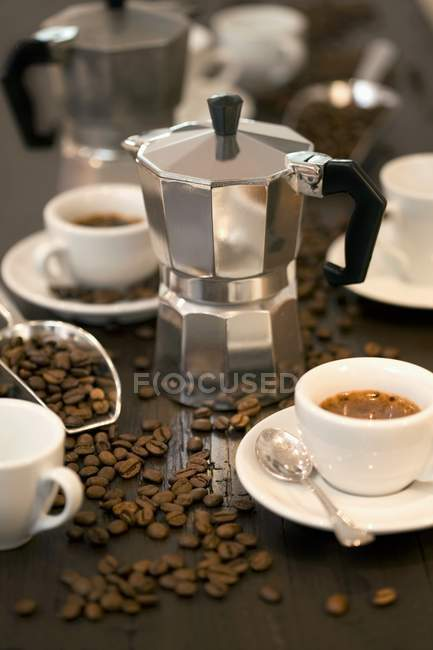 Coffee maker with cups of espresso — Stock Photo
