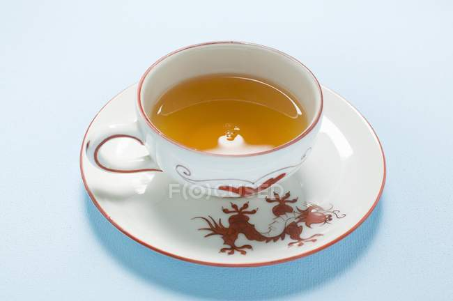 Tea in Asian cup and saucer — Stock Photo
