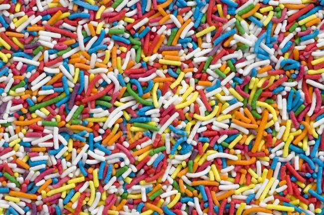 Primo piano vista full-frame di spruzzi colorati — Foto stock