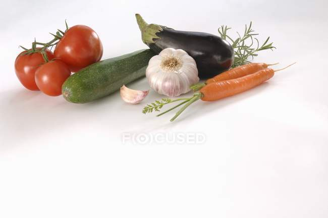 Vegetable still life on white background — Stock Photo