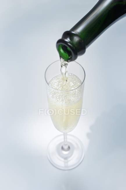 Pouring a glass of sparkling wine — Stock Photo