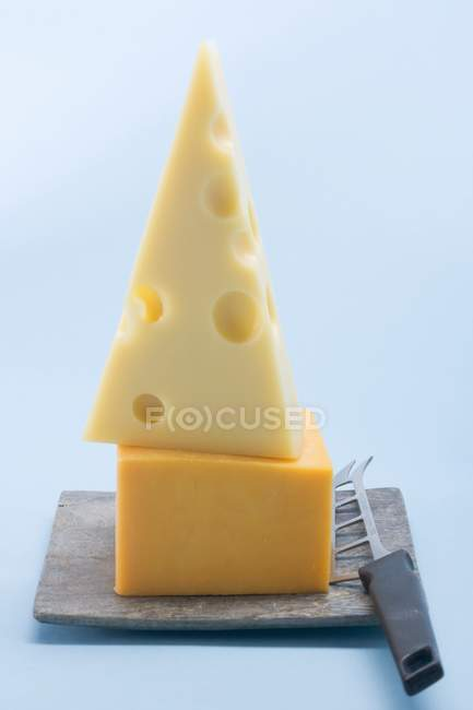 Cheddar with cheese knife — Stock Photo