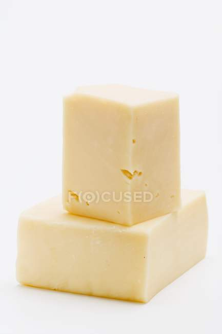 Pieces of Cheddar cheese — Stock Photo