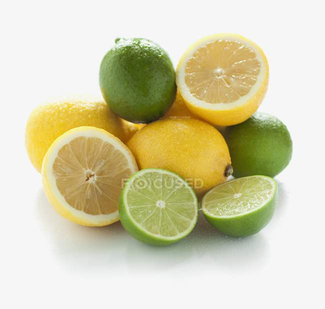 Fresh halved limes and lemons — Stock Photo