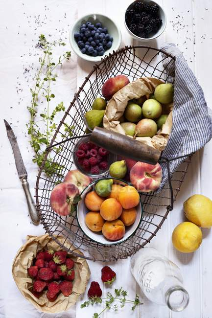 Wire basket with fresh summer fruits — Stock Photo