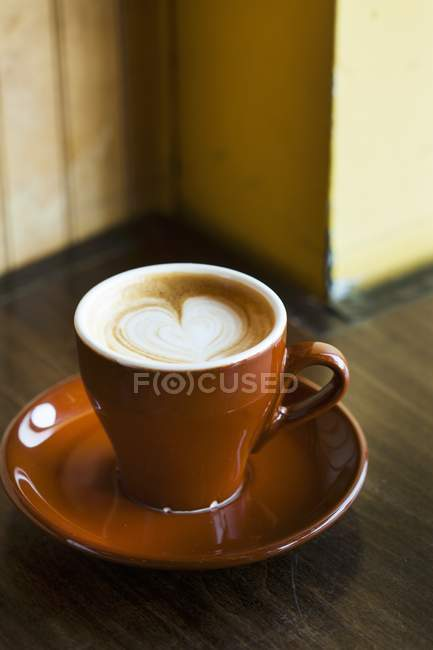 Latte with Heart Design in cup — Stock Photo