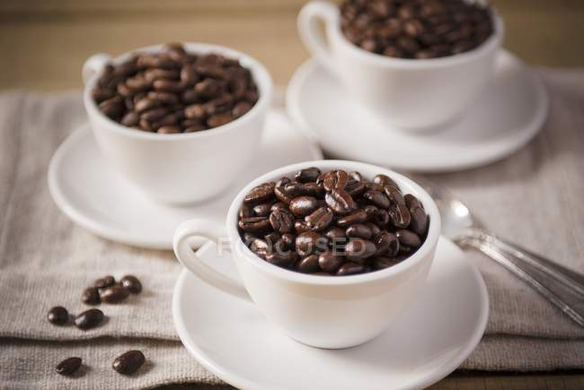 Coffee Cups Filled with Coffee Beans — Stock Photo