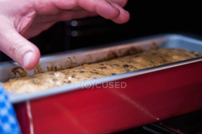 Fruitcake in a baking tin — Stock Photo