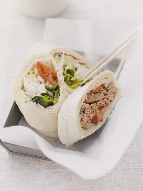 Closeup view of assorted mini wraps with salads and meat — Stock Photo
