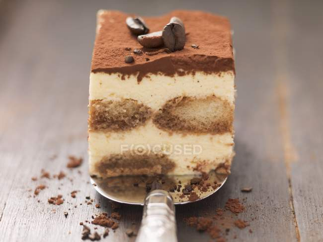 Tiramisu with mocha beans on cake slice — Stock Photo