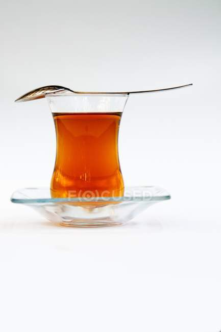 Asian tea in glass with spoon — Stock Photo