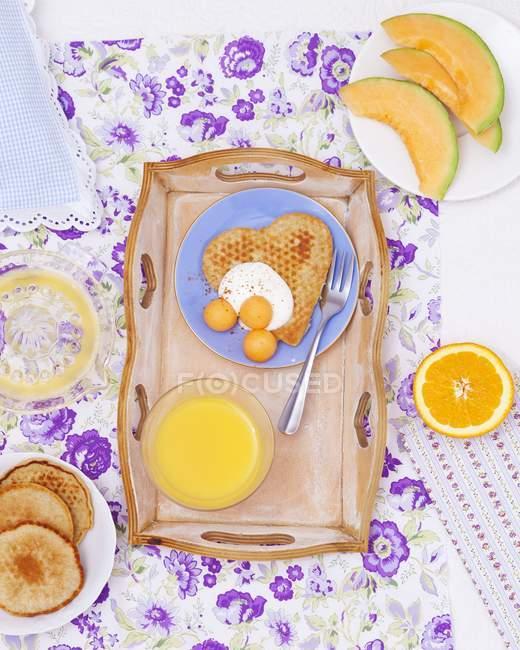 Breakfast tray with pancake — Stock Photo
