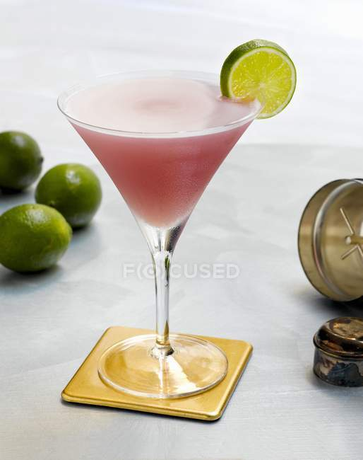 Cosmopolitan on a Coaster with a Lime Slice — Stock Photo