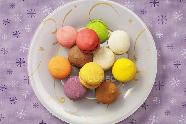 Colourful macaroons on plate — Stock Photo